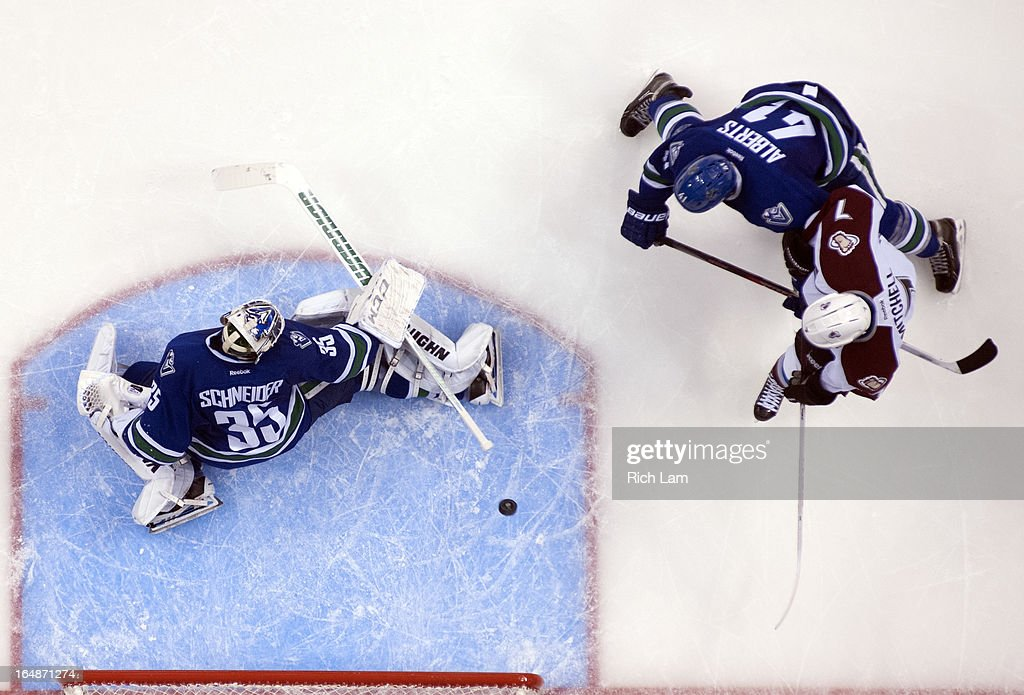 Goalie <a gi-track='captionPersonalityLinkClicked' href=/galleries/search?phrase=Cory+Schneider&family=editorial&specificpeople=696908 ng-click='$event.stopPropagation()'>Cory Schneider</a> #35 of the Vancouver Canucks makes a save while John Mitchell #7 of the Colorado Avalanche and <a gi-track='captionPersonalityLinkClicked' href=/galleries/search?phrase=Andrew+Alberts&family=editorial&specificpeople=622259 ng-click='$event.stopPropagation()'>Andrew Alberts</a> #41 of the Vancouver Canucks battle for position during the third period in NHL action on March 28, 2013 at Rogers Arena in Vancouver, British Columbia, Canada.