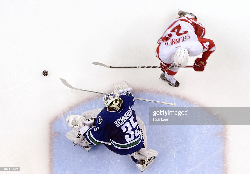 Goalie <a gi-track='captionPersonalityLinkClicked' href=/galleries/search?phrase=Cory+Schneider&family=editorial&specificpeople=696908 ng-click='$event.stopPropagation()'>Cory Schneider</a> #35 of the Vancouver Canucks stops <a gi-track='captionPersonalityLinkClicked' href=/galleries/search?phrase=Damien+Brunner&family=editorial&specificpeople=6931570 ng-click='$event.stopPropagation()'>Damien Brunner</a> #24 of the Detroit Red Wings during the shootout in NHL action to defeat the Red Wings 2-1 on April 20, 2013 at Rogers Arena in Vancouver, British Columbia, Canada.