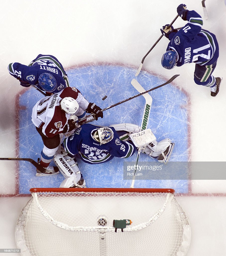 Goalie <a gi-track='captionPersonalityLinkClicked' href=/galleries/search?phrase=Cory+Schneider&family=editorial&specificpeople=696908 ng-click='$event.stopPropagation()'>Cory Schneider</a> #35 of the Vancouver Canucks stops <a gi-track='captionPersonalityLinkClicked' href=/galleries/search?phrase=Jamie+McGinn&family=editorial&specificpeople=537964 ng-click='$event.stopPropagation()'>Jamie McGinn</a> #11 of the Colorado Avalanche in close while <a gi-track='captionPersonalityLinkClicked' href=/galleries/search?phrase=Andrew+Ebbett&family=editorial&specificpeople=4143929 ng-click='$event.stopPropagation()'>Andrew Ebbett</a> #25 and <a gi-track='captionPersonalityLinkClicked' href=/galleries/search?phrase=Mason+Raymond&family=editorial&specificpeople=4521385 ng-click='$event.stopPropagation()'>Mason Raymond</a> #21 of the Canucks help defend on the play during the first period in NHL action on March 28, 2013 at Rogers Arena in Vancouver, British Columbia, Canada.