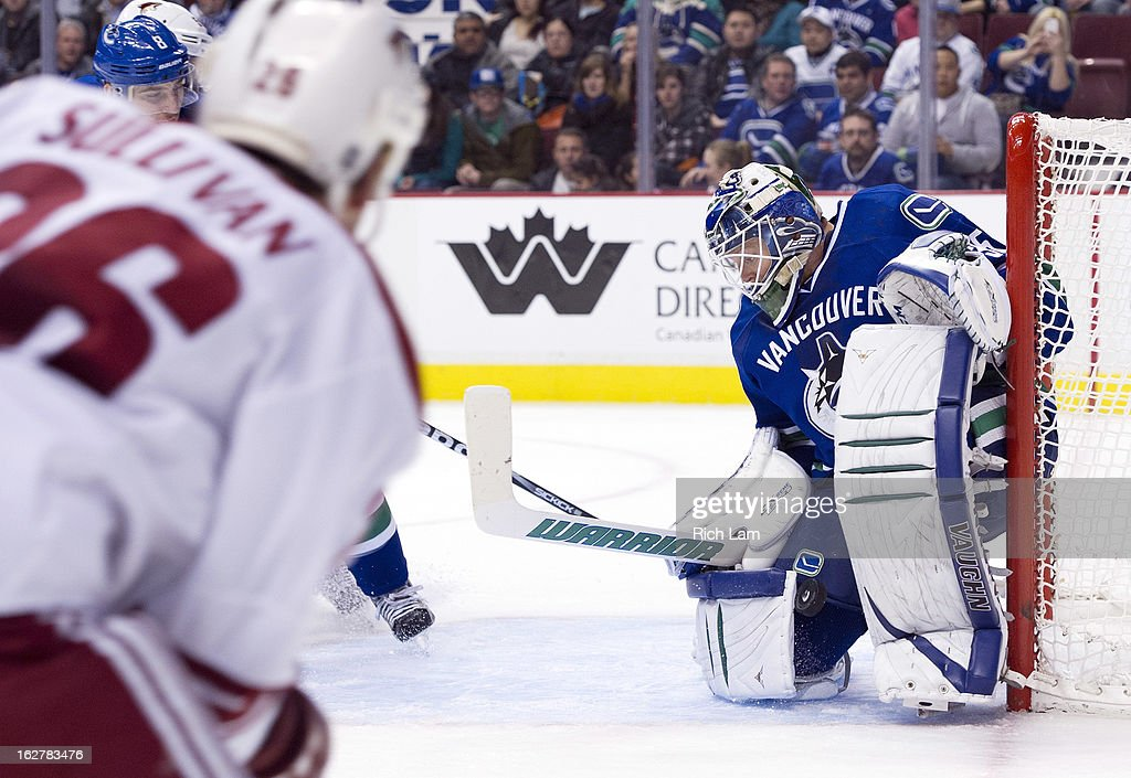 Goalie <a gi-track='captionPersonalityLinkClicked' href=/galleries/search?phrase=Cory+Schneider&family=editorial&specificpeople=696908 ng-click='$event.stopPropagation()'>Cory Schneider</a> #35 of the Vancouver Canucks stops the shot of <a gi-track='captionPersonalityLinkClicked' href=/galleries/search?phrase=Steve+Sullivan&family=editorial&specificpeople=201723 ng-click='$event.stopPropagation()'>Steve Sullivan</a> #26 of the Phoenix Coyotes during the third period in NHL action on February 26, 2013 at Rogers Arena in Vancouver, British Columbia, Canada.