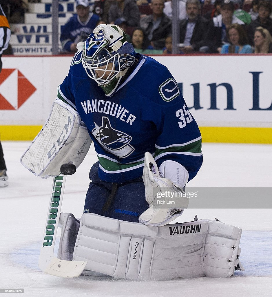 Goalie <a gi-track='captionPersonalityLinkClicked' href=/galleries/search?phrase=Cory+Schneider&family=editorial&specificpeople=696908 ng-click='$event.stopPropagation()'>Cory Schneider</a> #35 of the Vancouver Canucks tries to control the rebound after making a save against the Columbus Blue Jackets during the third period in NHL action on March 26, 2013 at Rogers Arena in Vancouver, British Columbia, Canada.