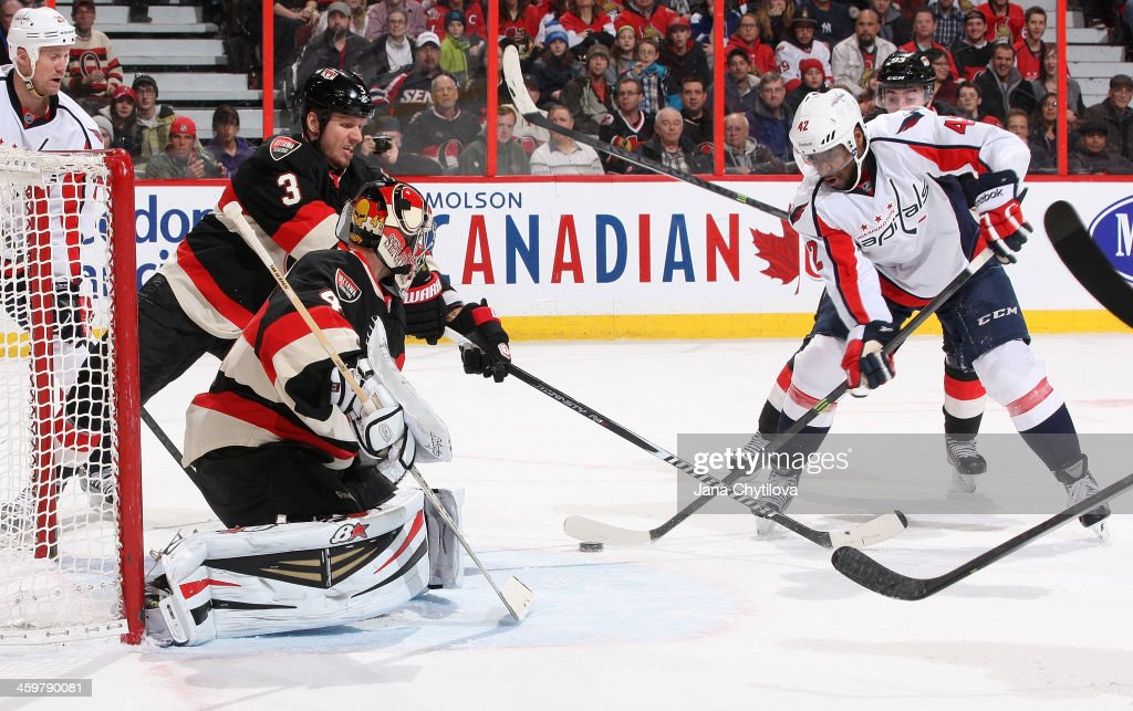 Goalie <a gi-track='captionPersonalityLinkClicked' href=/galleries/search?phrase=Craig+Anderson&family=editorial&specificpeople=211238 ng-click='$event.stopPropagation()'>Craig Anderson</a> #41 and <a gi-track='captionPersonalityLinkClicked' href=/galleries/search?phrase=Marc+Methot&family=editorial&specificpeople=2216900 ng-click='$event.stopPropagation()'>Marc Methot</a> #3 of the Ottawa Senators defend against Joel Ward #42 of the Washington Capitals during an NHL game at Canadian Tire Centre on December 30, 2013 in Ottawa, Ontario, Canada.
