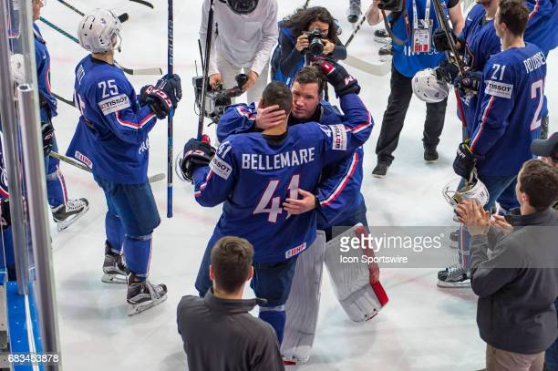 Goalie Cristobal Huet hugs with PierreEdouard Bellemare after the Ice Hockey World Championship between France and Slovenia at AccorHotels Arena in...