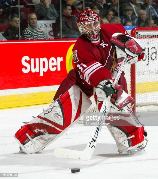 Goalie Curtis Joseph of the Phoenix Coyotes clears the puck against the Montreal Canadiens at the Bell Centre December 13 2005 in Montreal Canada