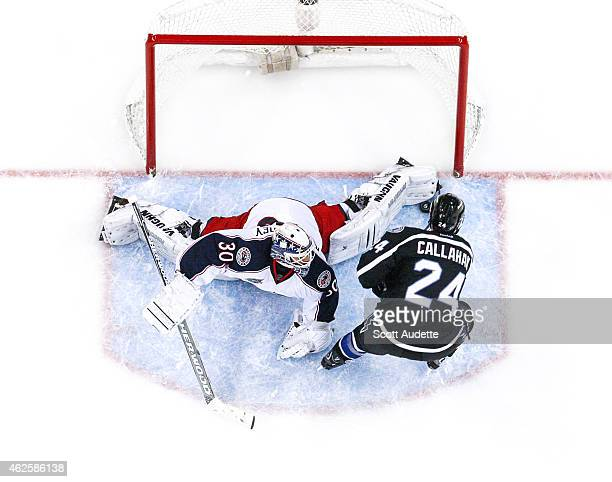 Goalie Curtis McElhinney of the Columbus Blue Jackets saves a shot by Ryan Callahan during the second period at the Amalie Arena on January 31 2015...