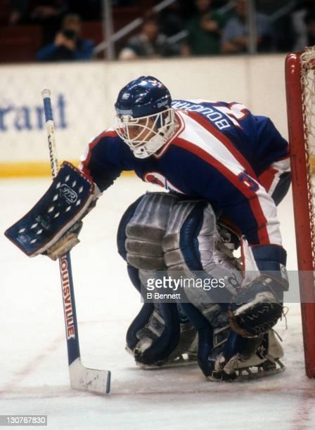 Goalie Dan Bouchard of the Winnipeg Jets defends the net during an NHL game against the New Jersey Devils on November 26 1985 at the Brendan Byrne...