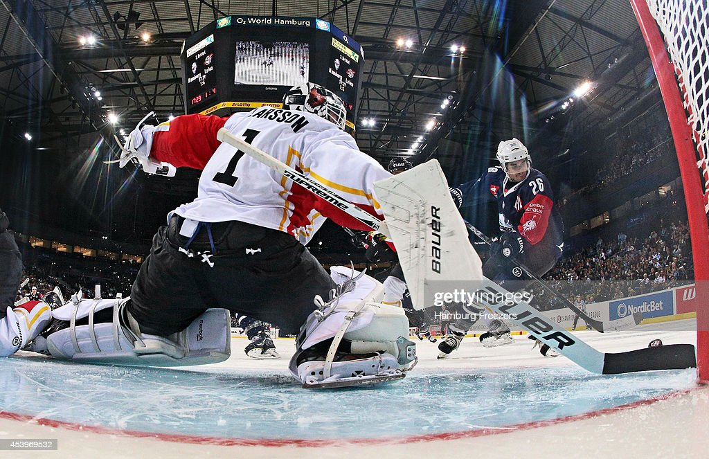 Goalie Daniel Larsson of Lulea saves a goal against Marty Sertich #26 of Hamburg Freezers during the Champions Hockey League group stage game between Hamburg Freezers and Lulea Hockey on August 22, 2014 in Hamburg, Germany.