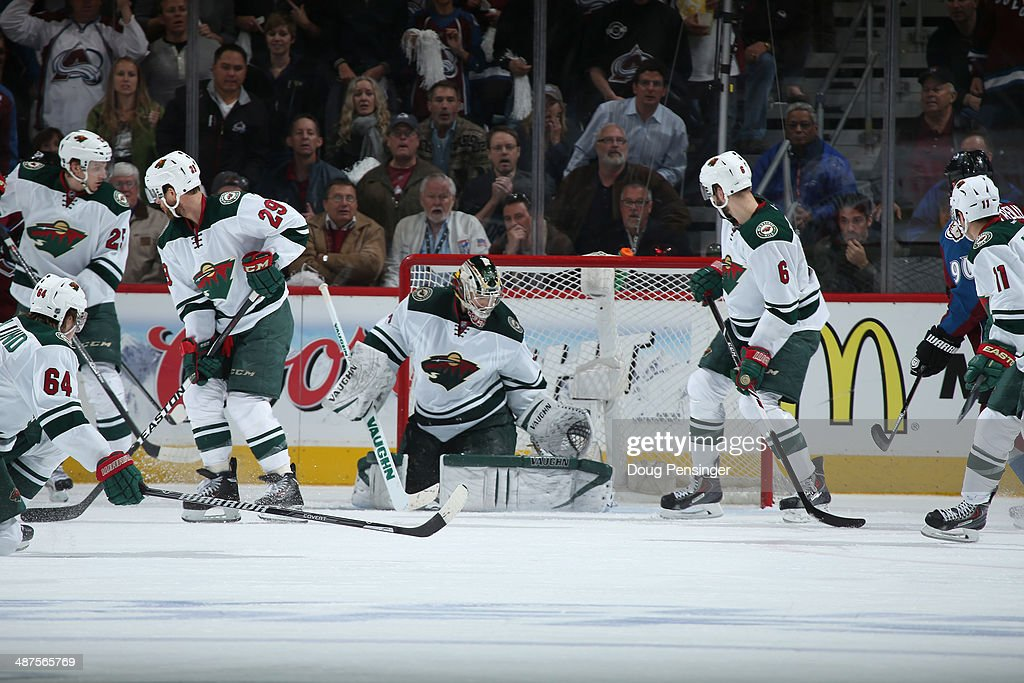 Goalie Darcy Kuemper #35 of the Minnesota Wild defends the goal as Mikael Granlund #64, Jonas Brodin #25, Jason Pominville #29, Marco Scandella #6 and Zach Parise #11 of the Minnesota Wild follow the play against the Colorado Avalanche Game Seven of the First Round of the 2014 NHL Stanley Cup Playoffs at Pepsi Center on April 30, 2014 in Denver, Colorado. The Wild defeated the Avalanche in overtime 5-4 to win the series.