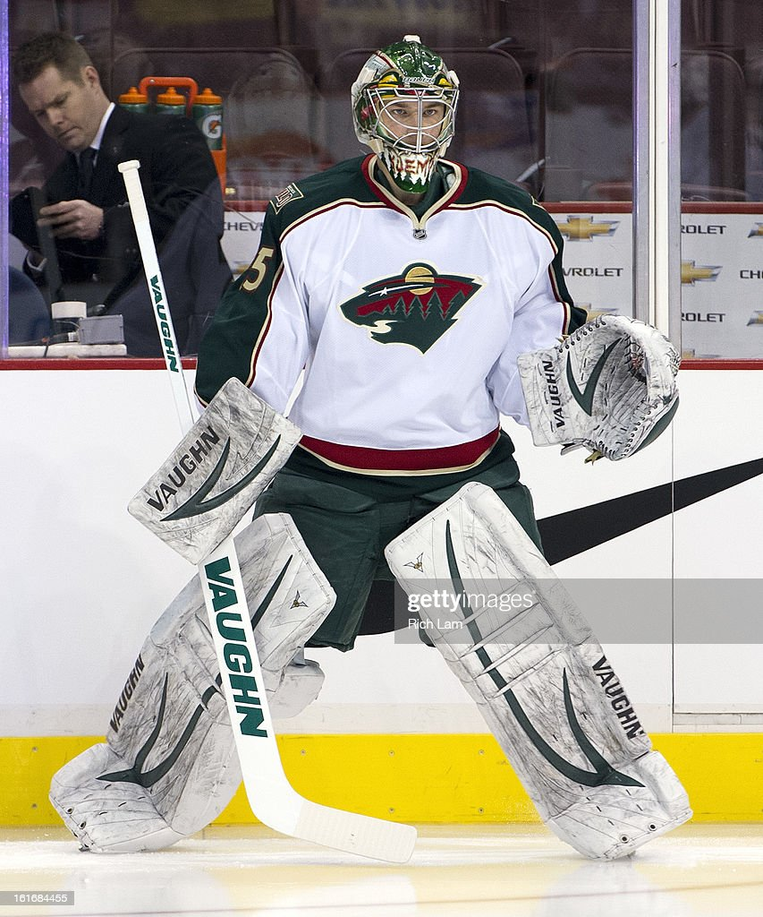 Goalie Darcy Kuemper #35 of the Minnesota Wild during the pre-game warm up prior to NHL action against the Vancouver Canucks on February 12, 2013 at Rogers Arena in Vancouver, British Columbia, Canada.