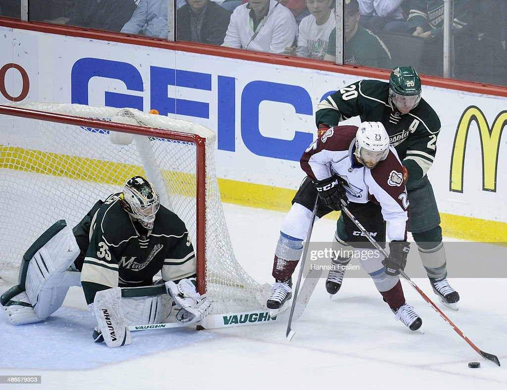 Goalie <a gi-track='captionPersonalityLinkClicked' href=/galleries/search?phrase=Darcy+Kuemper&family=editorial&specificpeople=6270733 ng-click='$event.stopPropagation()'>Darcy Kuemper</a> #35 of the Minnesota Wild looks on as teammate <a gi-track='captionPersonalityLinkClicked' href=/galleries/search?phrase=Ryan+Suter&family=editorial&specificpeople=583306 ng-click='$event.stopPropagation()'>Ryan Suter</a> #20 battles <a gi-track='captionPersonalityLinkClicked' href=/galleries/search?phrase=Maxime+Talbot&family=editorial&specificpeople=2078922 ng-click='$event.stopPropagation()'>Maxime Talbot</a> #25 of the Colorado Avalanche who brings the puck around the net during the second period in Game Four of the First Round of the 2014 NHL Stanley Cup Playoffs on April 24, 2014 at Xcel Energy Center in St Paul, Minnesota. The Wild defeated the Avalanche 2-1.