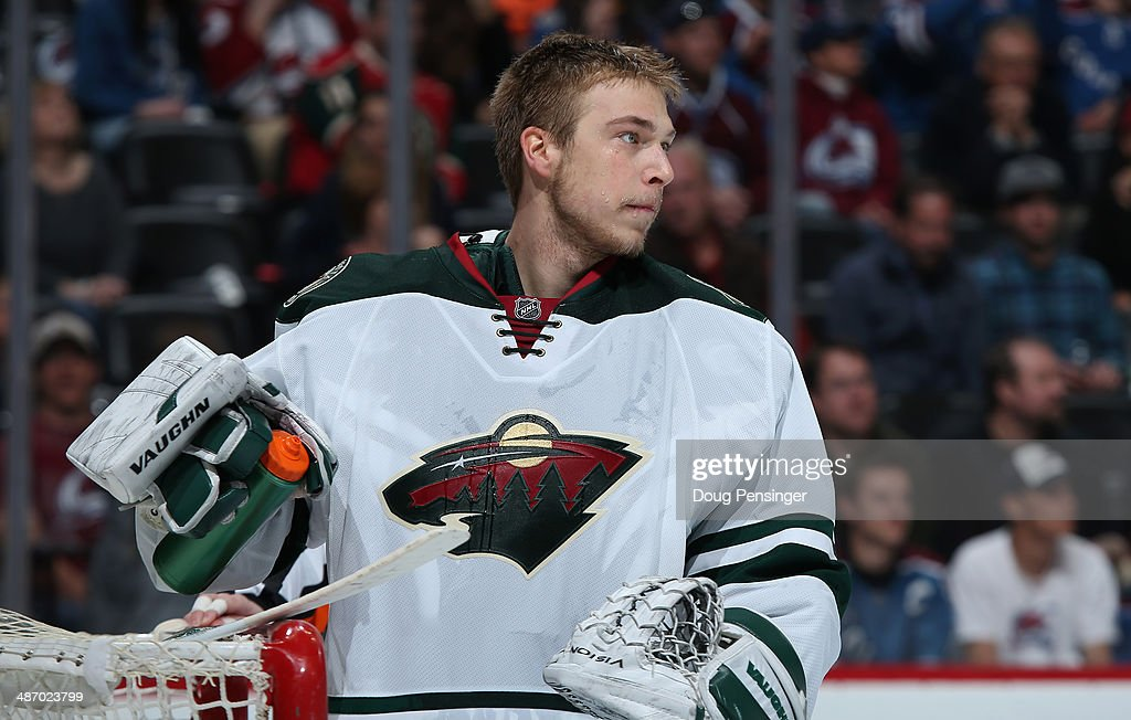 Goalie Darcy Kuemper of the Minnesota Wild looks on during a break in the action against the Colorado Avalanche Game Five of the First Round of the...