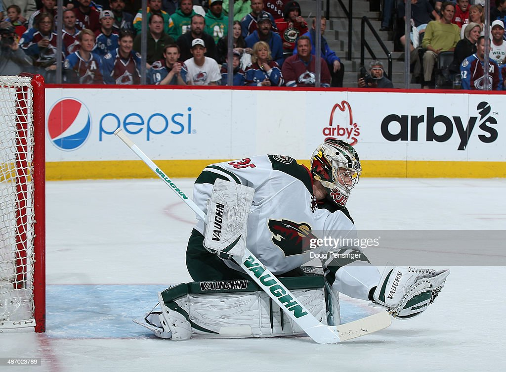 Goalie Darcy Kuemper of the Minnesota Wild makes a glove save against the Colorado Avalanche Game Five of the First Round of the 2014 NHL Stanley Cup...