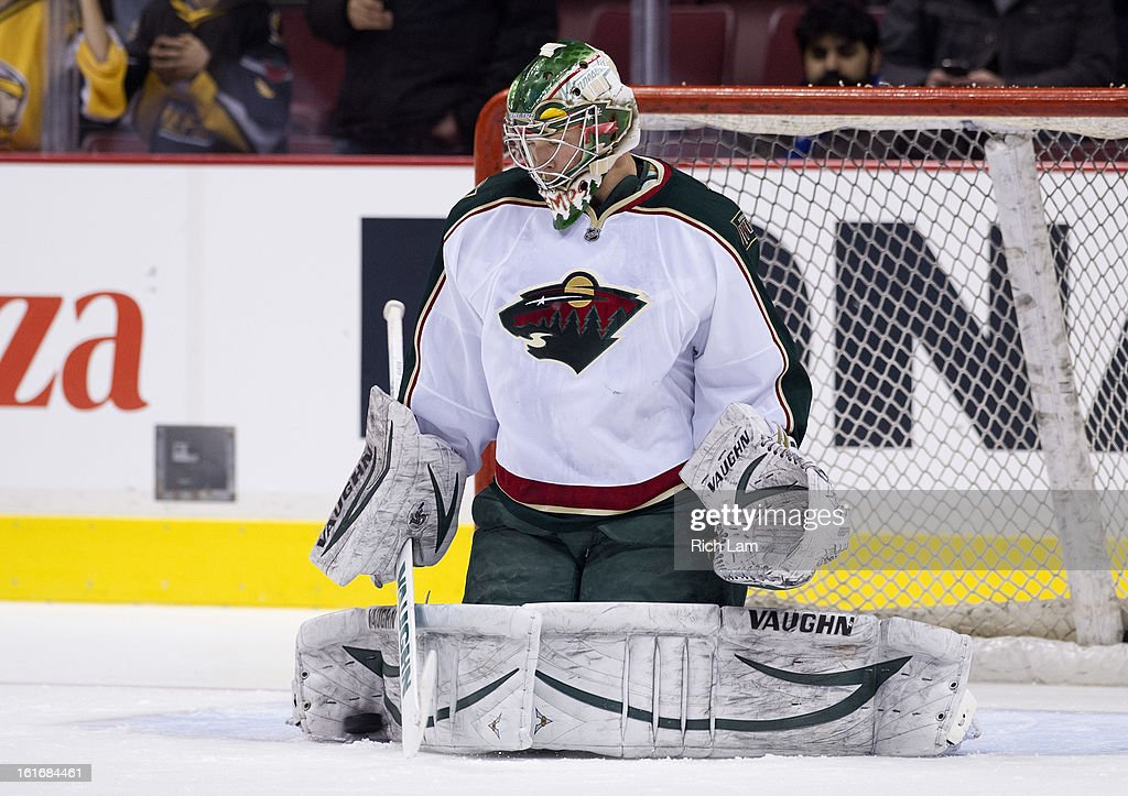 Goalie Darcy Kuemper #35 of the Minnesota Wild makes a save during the pre-game warm up prior to NHL action against the Vancouver Canucks on February 12, 2013 at Rogers Arena in Vancouver, British Columbia, Canada.