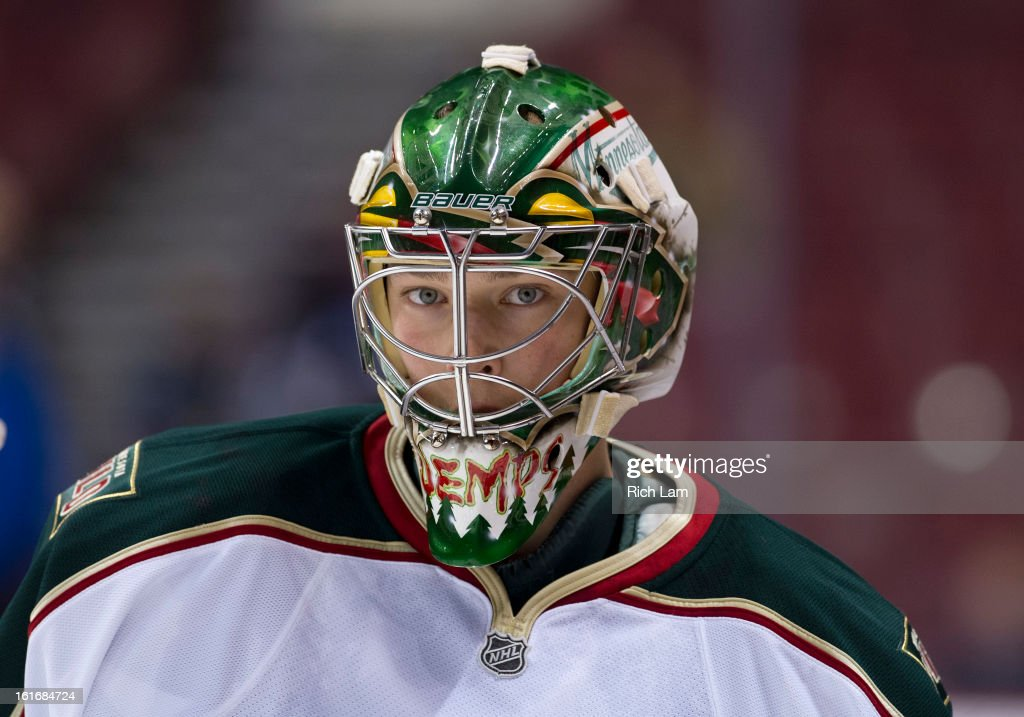 Goalie Darcy Kuemper #35 of the Minnesota Wild skates during the pre-game warm up prior to NHL action against the Vancouver Canucks on February 12, 2013 at Rogers Arena in Vancouver, British Columbia, Canada.