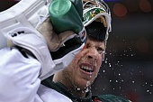 Goalie Darcy Kuemper of the Minnesota Wild splashes water on his face against the Washington Capitals during the second period at Verizon Center on...