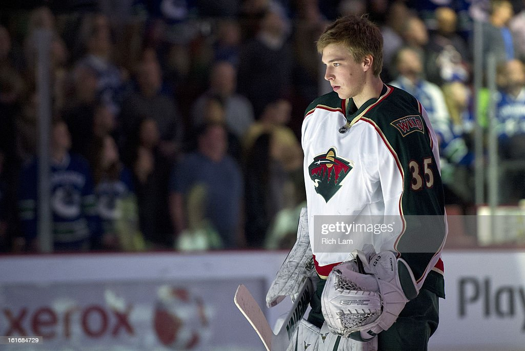 Goalie Darcy Kuemper #35 of the Minnesota Wild stand during the national anthem prior to NHL action against the Vancouver Canucks on February 12, 2013 at Rogers Arena in Vancouver, British Columbia, Canada.