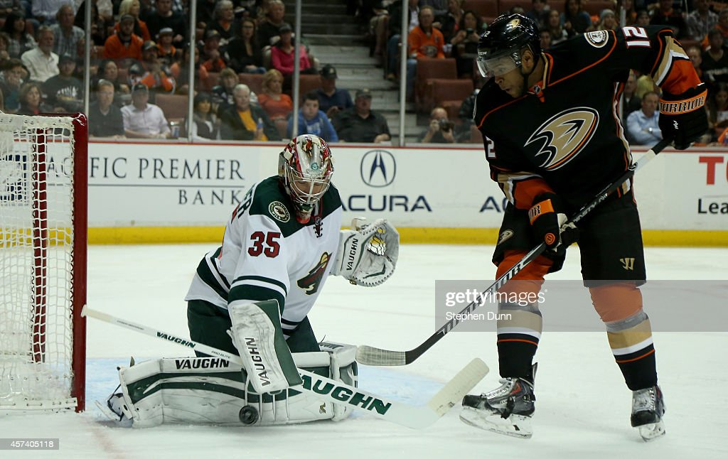 Goalie Darcy Kuemper of the Minnesota Wild stops the puck i n front of Devante SmithPelly of the Anaheim Ducks at Honda Center on October 17 2014 in...