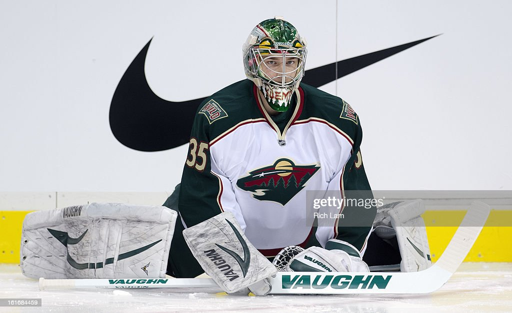 Goalie Darcy Kuemper #35 of the Minnesota Wild stretches during the pre-game warm up prior to NHL action against the Vancouver Canucks on February 12, 2013 at Rogers Arena in Vancouver, British Columbia, Canada.