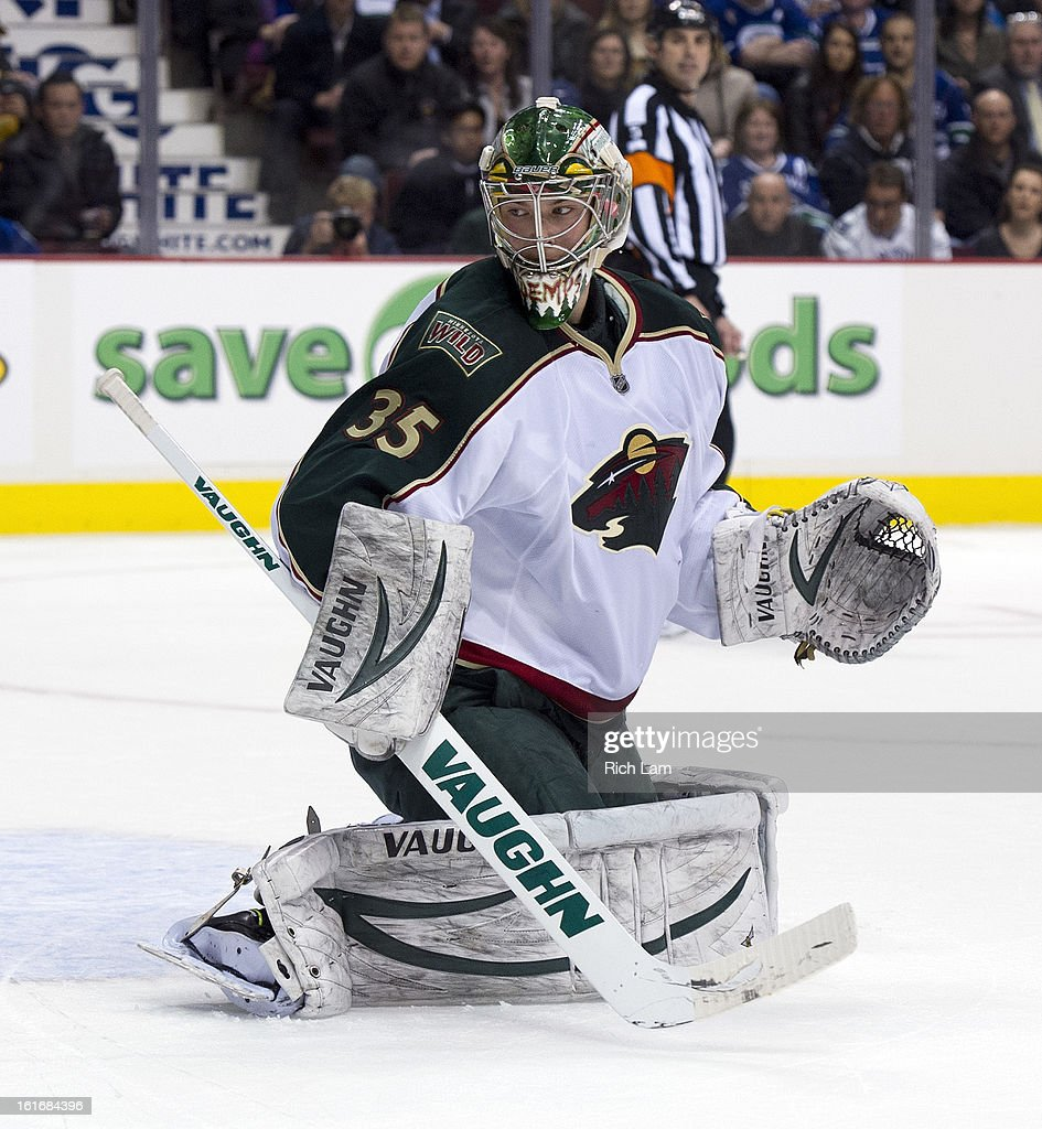 Goalie Darcy Kuemper #35 of the Minnesota Wild watches the puck go into the corner during NHL action against the Vancouver Canucks on February 12, 2013 at Rogers Arena in Vancouver, British Columbia, Canada.