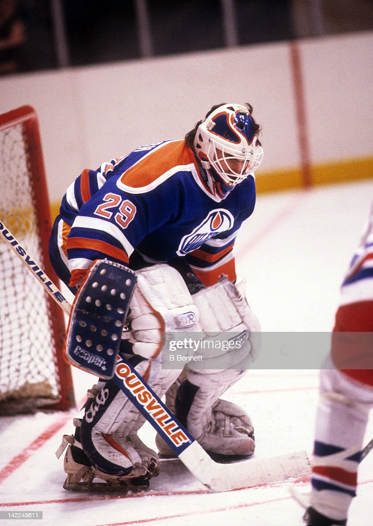 Goalie Daryl Reaugh of the Edmonton Oilers defends the net during an NHL game against the New York Rangers circa 1988 at the Madison Square Garden in...