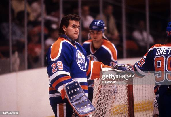 Goalie Daryl Reaugh of the Edmonton Oilers looks on during warm ups before an NHL game against the New York Rangers circa 1988 at the Madison Square...