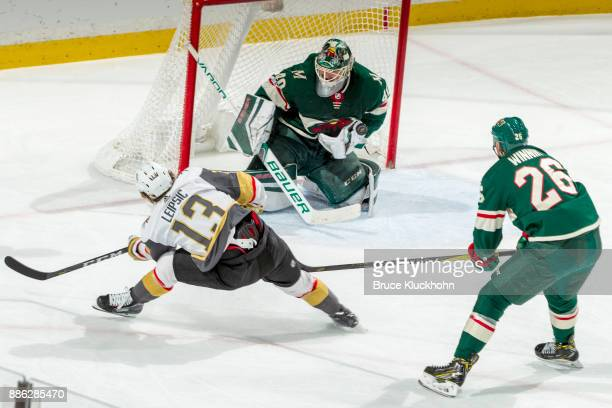 Goalie Devan Dubnyk makes a save while his Minnesota Wild teammate Daniel Winnik defends Brendan Leipsic of the Vegas Golden Knights during the game...
