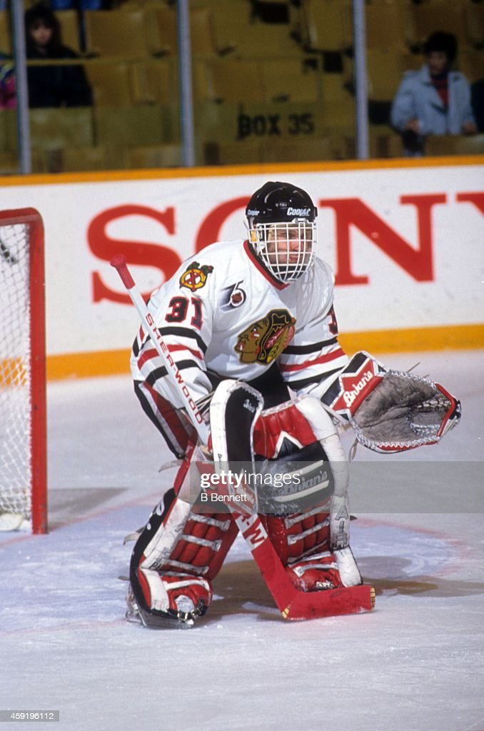 Goalie Dominik Hasek of the Chicago Blackhawks defends the net during an NHL game against the Toronto Maple Leafs on March 21 1992 at the Maple Leaf...