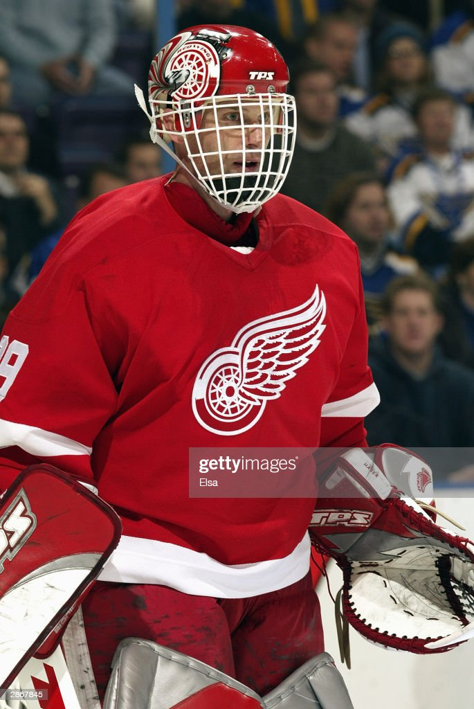 Goalie Dominik Hasek of the Detroit Red Wings gets into position during the game against the St Louis Blues on December 4 2003 at the Savvis Center...