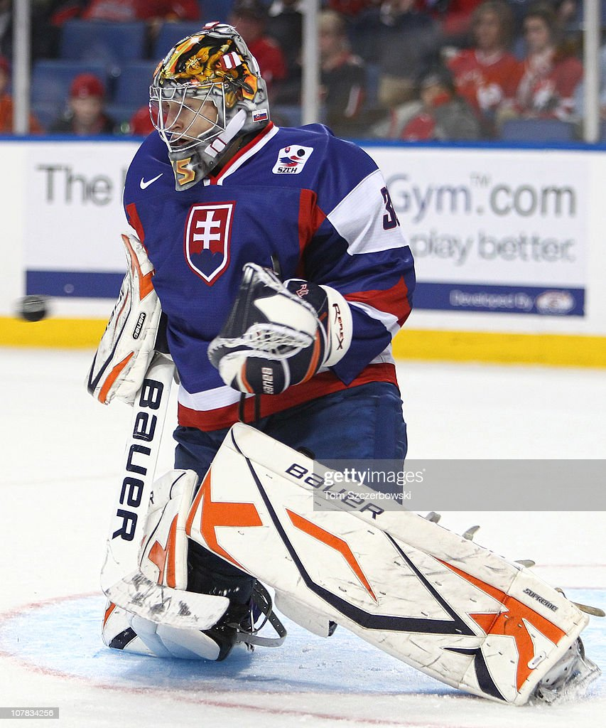 Goalie Dominik Riecicky #30 of Slovakia makes a save during the 2011 IIHF World U20 Championship game between Slovakia and Finland on December 31, 2010 at HSBC Arena in Buffalo, New York.