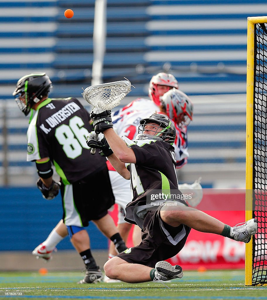 Goalie Drew Adams #14 of the New York Lizards makes a save during a Major League Lacrosse game against the Boston Cannons at James M. Shuart Stadium on April 28, 2013 in Hempstead, New York.