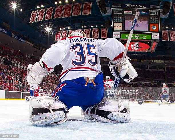 Goalie Dustin Tokarski of the Montreal Canadiens makes a pad save during a NHL game against the Detroit Red Wings on November 16 2014 at Joe Louis...