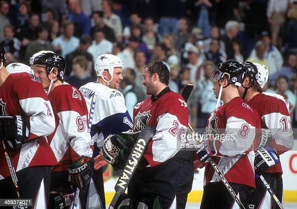 Goalie Ed Belfour of North America and the Dallas Stars shakes hands with players from the World after the 1999 49th NHL AllStar Game on January 24...