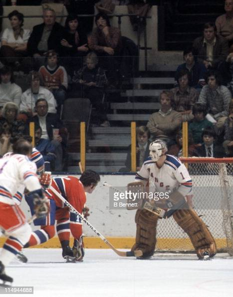 Goalie Ed Giacomin of the New York Rangers defends the net during an NHL game against the Montreal Canadiens circa 1971 at the Madison Square Garden...