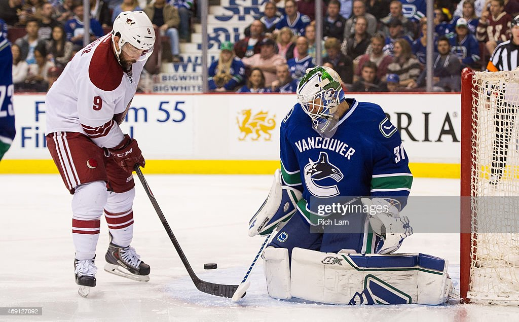 Goalie Eddie Lack #31 of the Vancouver Canucks stops Sam Gagner #9 of the Arizona Coyotes in close in NHL action on April 9, 2015 at Rogers Arena in Vancouver, British Columbia, Canada.
