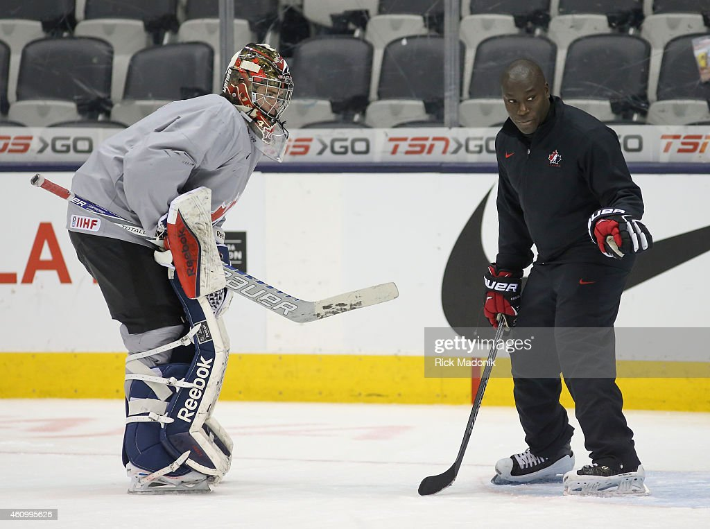 TORONTO - JANUARY 3 - Goalie Eric Comrie gets some tips from Fred Brathwaite, who helps out with the goal tenders. Team Canada practice at the Air Canada Centre on January 3, 2015. Canada is preparing for their Semi Final matchup against Slovakia on Sunday. All part of the 2015 IIHF World Junior Hockey tournament.