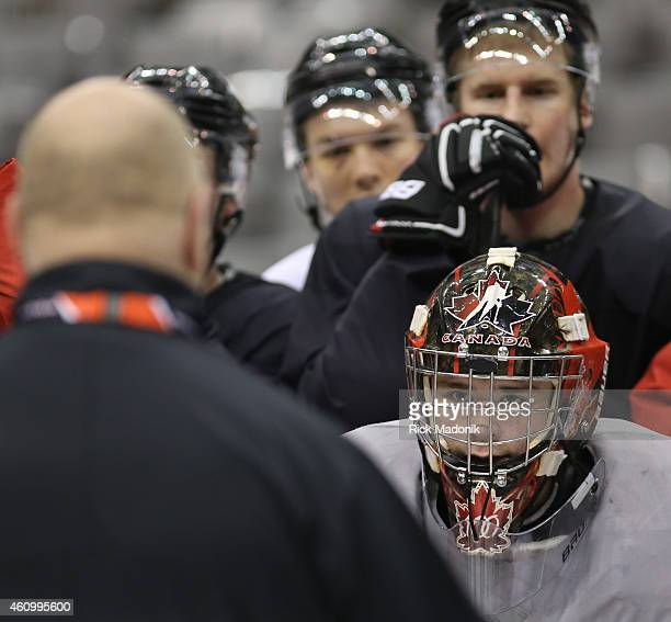 TORONTO JANUARY 3 Goalie Eric Comrie listens to coach Benoit Groulx during the morning skate Team Canada practice at the Air Canada Centre on January...