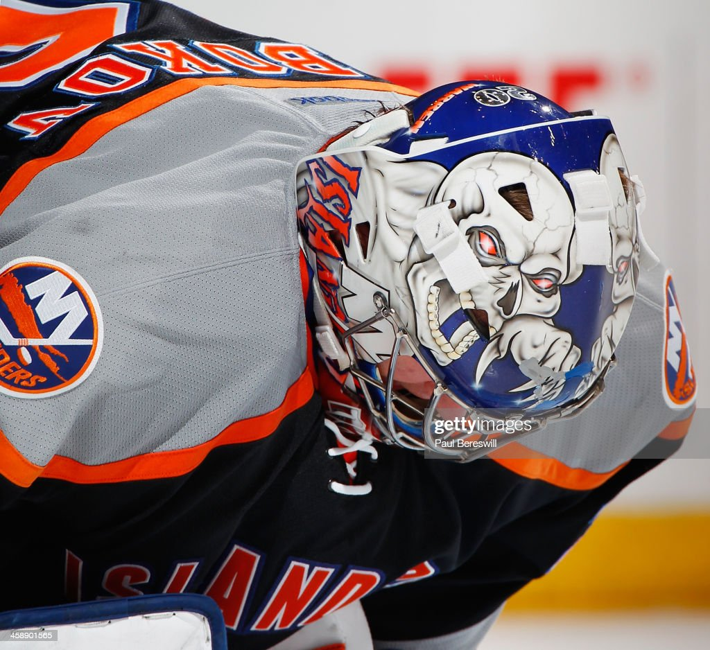 Goalie Evgeni Nabokov #20 of the New York Islanders looks down during an NHL hockey game against the Anaheim Ducks at Nassau Veterans Memorial Coliseum on December 21, 2013 in Uniondale, New York.
