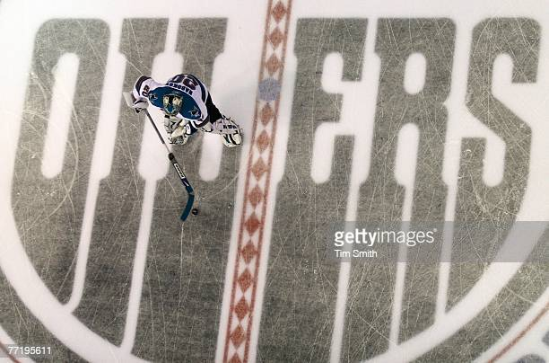 Goalie Evgeni Nabokov # of the San Jose Sharks skates over the Edmonton Oilers centre ice logo during warmup prior to the first period of the Oilers...
