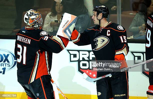 Goalie Frederik Andersen and Ryan Getzlaf of the Anaheim Ducks celebrate after the game against the Los Angeles Kings during preseason at Honda...