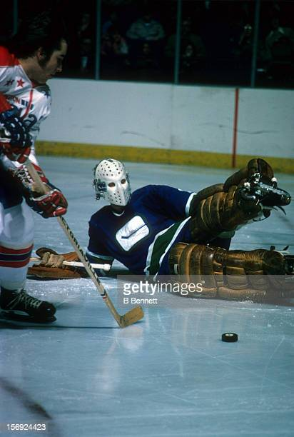 Goalie Gary Smith of the Vancouver Canucks looks to make the save during an NHL game against the Washington Capitals circa 1975 at the Captial Centre...