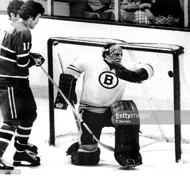 Goalie Gerry Cheevers of the Boston Bruins can't save the goal as Yvon Lambert of the Montreal Canadiens looks on during Game 6 of the 1978 Stanley...