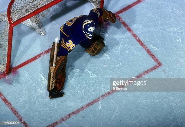 Goalie Gerry Desjardins of the Buffalo Sabres defends the net during an NHL game against the Detroit Red Wings on February 19 1977 at the Detroit...