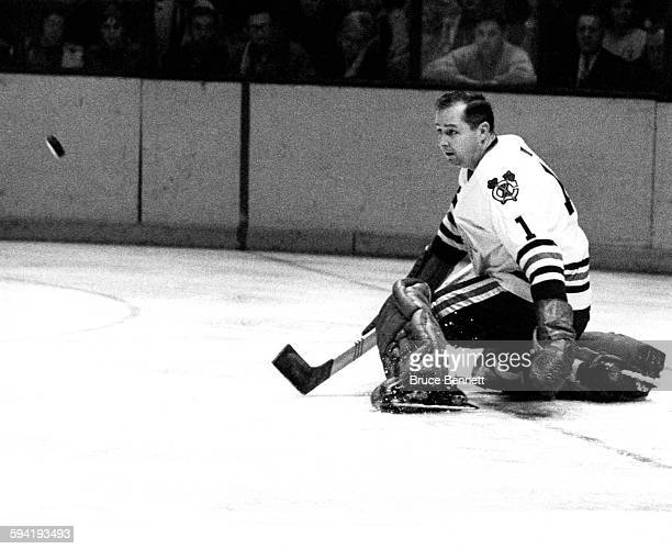 Goalie Glenn Hall of the Chicago Blackhawks goes to make the save during an NHL game against the New York Rangers on December 5 1965 at the Madison...