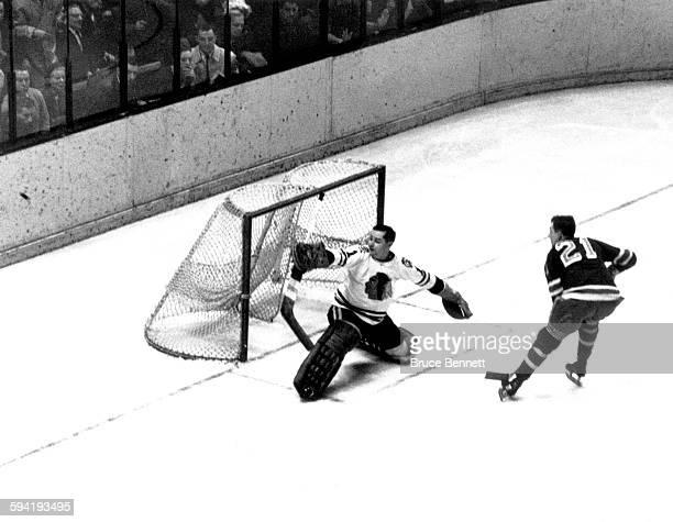 Goalie Glenn Hall of the Chicago Blackhawks makes the save on Camille Henry of the New York Rangers on December 23 1962 at the Madison Square Garden...