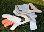 Goalie gloves lie on the ground by the bench of the United States before an international friendly soccer game against Mexico September 13 2014 at...