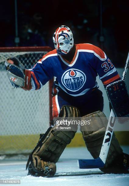 Goalie Grant Fuhr defends the net during the 1984 Stanley Cup Finals against the New York Islanders in May 1984 at the Nassau Coliseum in Uniondale...