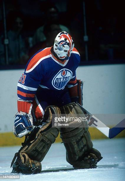 Goalie Grant Fuhr looks to make the save during the 1984 Stanley Cup Finals against the New York Islanders in May 1984 at the Nassau Coliseum in...