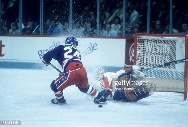 Goalie Grant Fuhr of Team Canada makes the save against Team USA during the 1984 Canada Cup game on September 3 1984 at the Montreal Forum in...
