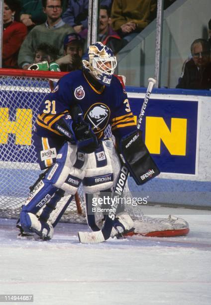 Goalie Grant Fuhr of the Buffalo Sabres defends the net during an NHL game against the Montreal Canadiens in March 1993 at the Montreal Forum in...