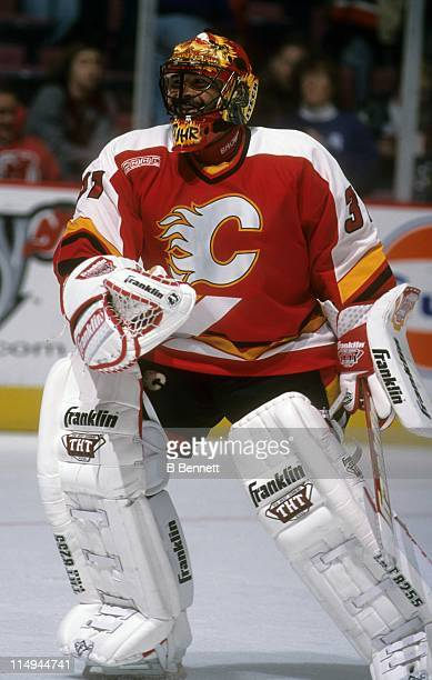 Goalie Grant Fuhr of the Calgary Flames skates on the ice before an NHL game against the New Jersey Devils on December 4 1999 at the Continental...